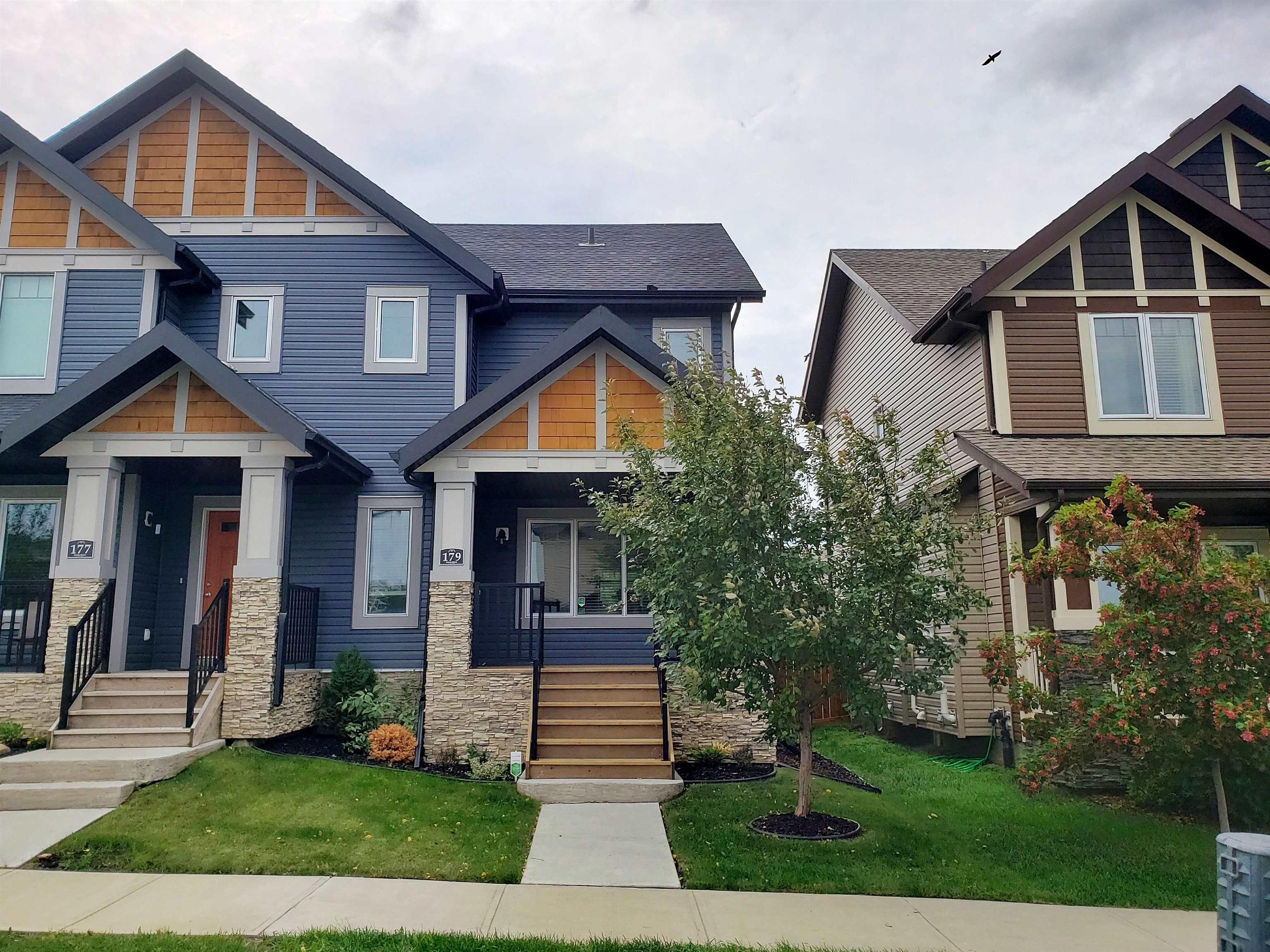 Main Photo: 179 HAWKS RIDGE Boulevard in Edmonton: Zone 59 House Half Duplex for sale : MLS®# E4261420