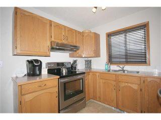 Photo 13: 35 WEST MCDOUGAL Road: Cochrane House for sale : MLS®# C4053037