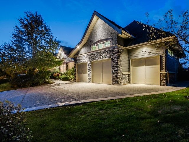 The mix of stone and siding adds a versatile feel to this present home. Covered front porch, triple garage and concrete driveway.
