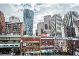 Photo 1: 202 110 2 Avenue SE in Calgary: Chinatown Apartment for sale : MLS®# A1089450