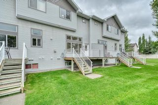 Photo 39: 66 Crystal Shores Cove: Okotoks Row/Townhouse for sale : MLS®# C4305435