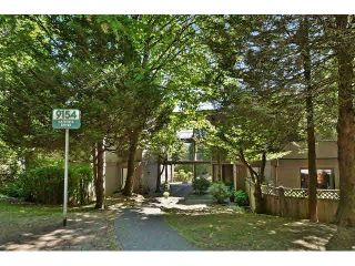 """Photo 1: 102 9154 SATURNA Drive in Burnaby: Simon Fraser Hills Townhouse for sale in """"MOUNTAIN WOOD"""" (Burnaby North)  : MLS®# V1141156"""