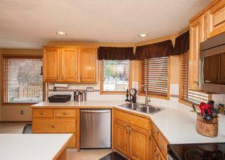Photo 13: 1119 SUNVISTA Road SE in Calgary: Sundance House for sale : MLS®# C4129627