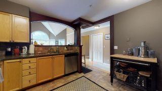 """Photo 6: 306 1468 PEMBERTON Avenue in Squamish: Downtown SQ Condo for sale in """"Marina Estates"""" : MLS®# R2409294"""