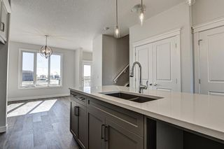 Photo 13: 136 Creekside Drive SW in Calgary: C-168 Semi Detached for sale : MLS®# A1108851