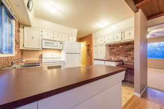 Photo 4: 7715 34 Avenue NW in Calgary: Bowness Detached for sale : MLS®# A1086301