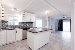 """Photo 2: 142 145 KING EDWARD Street in Coquitlam: Maillardville Manufactured Home for sale in """"MILL CREEK VILLAGE"""" : MLS®# R2518910"""