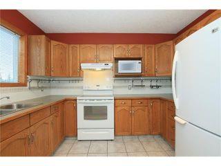 Photo 15: 74 WEST TERRACE Road: Cochrane House for sale : MLS®# C4073559