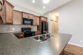 Photo 8: 305 Sunvale Crescent NE: High River Row/Townhouse for sale : MLS®# A1144470