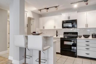 Photo 1: 103 920 Royal Avenue SW in Calgary: Lower Mount Royal Apartment for sale : MLS®# A1088426