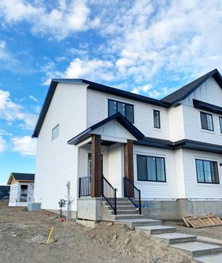 Main Photo: 420 Reynolds Avenue SW: Airdrie Semi Detached for sale : MLS®# A1139525