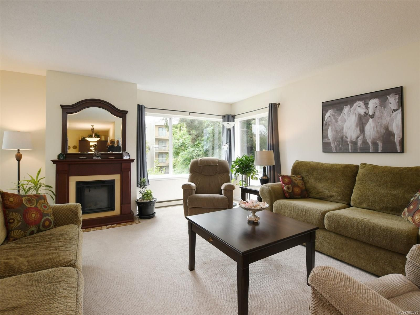 Fabulous 2 bedroom corner unit with oodles of natural light pouring in. Generous size living room. burning  Current owners have an electric fireplace in front of original wood burning fireplace.