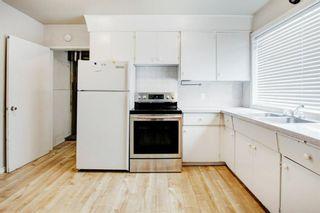 Photo 11: 411 Goddard Avenue NE in Calgary: Greenview Row/Townhouse for sale : MLS®# A1119433