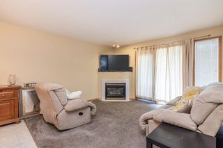 Photo 2: 104 5220 50A Avenue: Sylvan Lake Row/Townhouse for sale : MLS®# A1146974