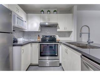 Photo 4: 105 3033 TERRAVISTA PLACE in Port Moody: Port Moody Centre Condo for sale : MLS®# R2334845