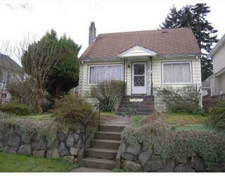 Photo 1: 5215 SLOCAN Street in Vancouver: Collingwood VE House for sale (Vancouver East)  : MLS®# V812437