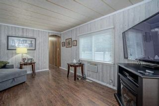 """Photo 8: 182 7790 KING GEORGE Boulevard in Surrey: East Newton Manufactured Home for sale in """"CRISPEN BAYS"""" : MLS®# R2616846"""