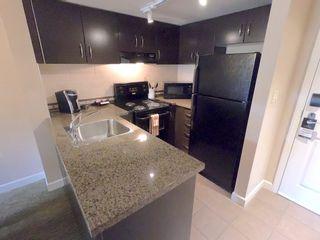 """Photo 6: 210 40900 TANTALUS Road in Squamish: Tantalus Condo for sale in """"Executive Suites Hotel"""" : MLS®# R2442400"""