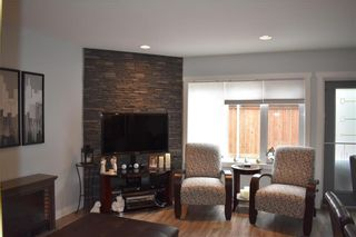 Photo 2: 2 908 Headmaster Row in Winnipeg: Condominium for sale (3H)  : MLS®# 202013029
