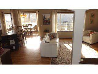 Photo 6: 155 SUNSET Close: Cochrane House for sale : MLS®# C4037159