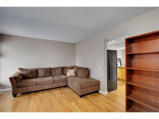 Photo 4: 24 WOODHILL Road SW in Calgary: Woodlands House for sale : MLS®# C4109351