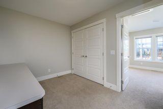 Photo 22: 524 Quarry Park Boulevard SE in Calgary: Douglasdale/Glen Row/Townhouse for sale : MLS®# A1084098