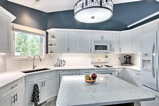 Photo 12: 64 Arbour Glen Close NW in Calgary: Arbour Lake Detached for sale : MLS®# A1117884