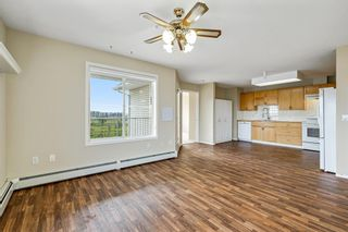 Photo 9: 301 305 1 Avenue NW: Airdrie Apartment for sale : MLS®# A1134588