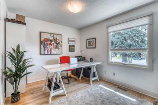 Photo 5: 424 135 Avenue SE in Calgary: Lake Bonavista Detached for sale : MLS®# A1095373