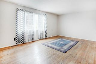 Photo 3: 411 Goddard Avenue NE in Calgary: Greenview Row/Townhouse for sale : MLS®# A1119433