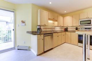 """Photo 8: 205 33401 MAYFAIR Avenue in Abbotsford: Central Abbotsford Condo for sale in """"MAYFAIR GARDENS"""" : MLS®# R2611471"""