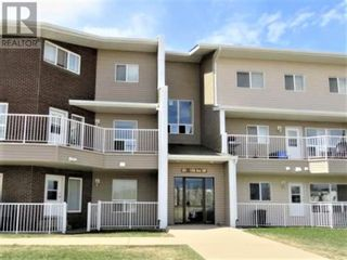 Photo 1: 301, 201 12 Street SW in Slave Lake: Condo for sale : MLS®# A1132711