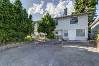 Photo 1: 1903 COMO LAKE Avenue in Coquitlam: Harbour Place House for sale : MLS®# R2463988