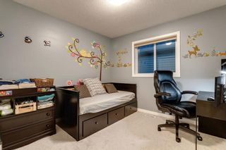 Photo 17: 144 Cougar Ridge Manor SW in Calgary: Cougar Ridge Detached for sale : MLS®# A1098625