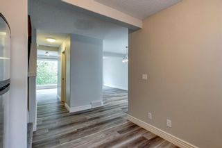 Photo 11: 249 Bridlewood Lane SW in Calgary: Bridlewood Row/Townhouse for sale : MLS®# A1124239
