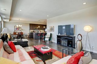 Photo 4: 82 Cranbrook Drive SE in Calgary: Cranston Row/Townhouse for sale : MLS®# A1075225