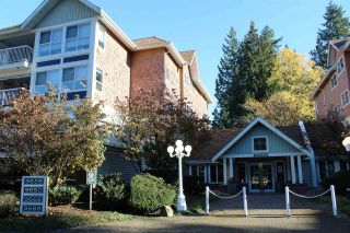 "Photo 1: 307 9650 148 Street in Surrey: Guildford Condo for sale in ""Hartford Woods"" (North Surrey)  : MLS®# R2353648"