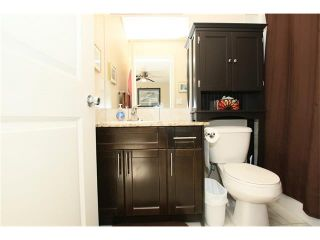 Photo 21: 1857 BAYWATER Street SW: Airdrie House for sale : MLS®# C4104542