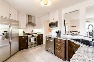 Photo 13: 143 Capri Avenue NW in Calgary: Charleswood Detached for sale : MLS®# A1114057