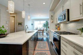 Photo 6: 340 Quarry Park Boulevard SE in Calgary: Douglasdale/Glen Row/Townhouse for sale : MLS®# A1123884