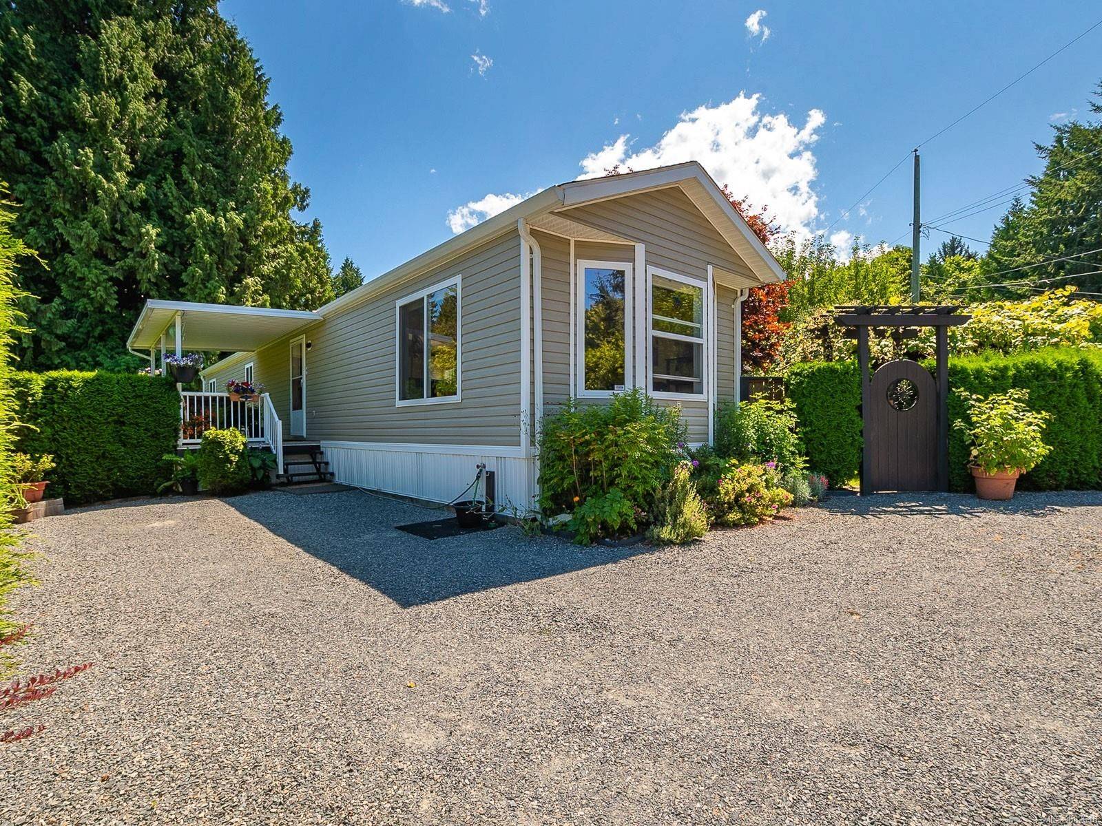 Main Photo: 1 6990 Dickinson Rd in : Na Lower Lantzville Manufactured Home for sale (Nanaimo)  : MLS®# 882618