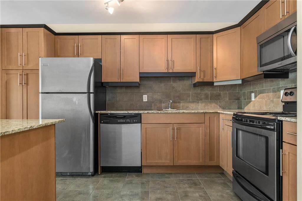 Photo 8: Photos: 406 565 Corydon Avenue in Winnipeg: Condominium for sale (1B)  : MLS®# 202025502