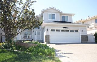 Main Photo: 2111 Woodpark Avenue SW in Calgary: Woodlands Detached for sale : MLS®# A1125343