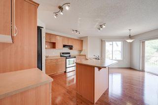 Photo 7: 1608 HODGSON Court in Edmonton: Zone 14 House for sale : MLS®# E4247502