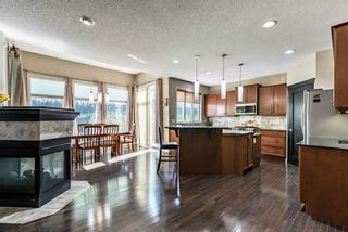 Photo 6: 157 Springbluff Boulevard SW in Calgary: Springbank Hill Detached for sale : MLS®# A1129724