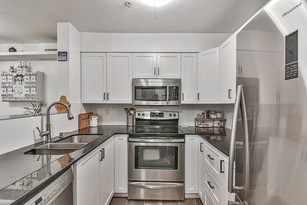 "Main Photo: 102 2401 HAWTHORNE Avenue in Port Coquitlam: Central Pt Coquitlam Condo for sale in ""Stonebrook"" : MLS®# R2617974"