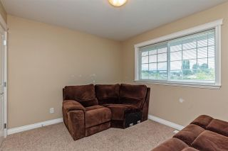 """Photo 29: 34745 3RD Avenue in Abbotsford: Poplar House for sale in """"HUNTINGDON VILLAGE"""" : MLS®# R2580704"""