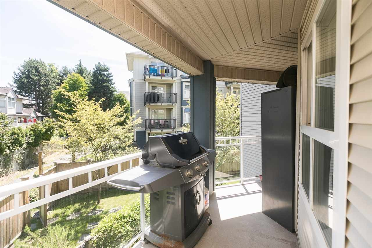 "Main Photo: 211 8115 121A Street in Surrey: Queen Mary Park Surrey Condo for sale in ""THE CROSSING"" : MLS®# R2384622"