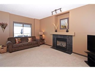 Photo 12: 18 CRYSTAL SHORES Place: Okotoks House for sale : MLS®# C4018955