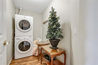 Photo 19: 301 305 1 Avenue NW: Airdrie Apartment for sale : MLS®# A1134588